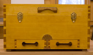 Tool chest front view with trademark tree carving
