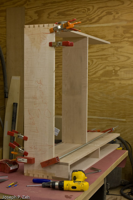 One end glued up at a time to reduce stress on the cabinetmaker.