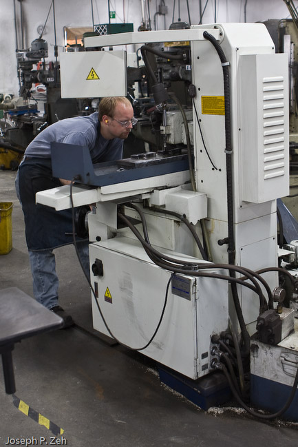 A member of the Shoulder Plane Group making sure the machine is grinding the side of the shoulder plane properly.