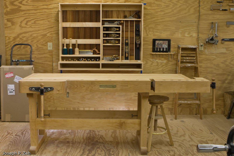 Nearly comleted hand tool cabinet next to LN bench.
