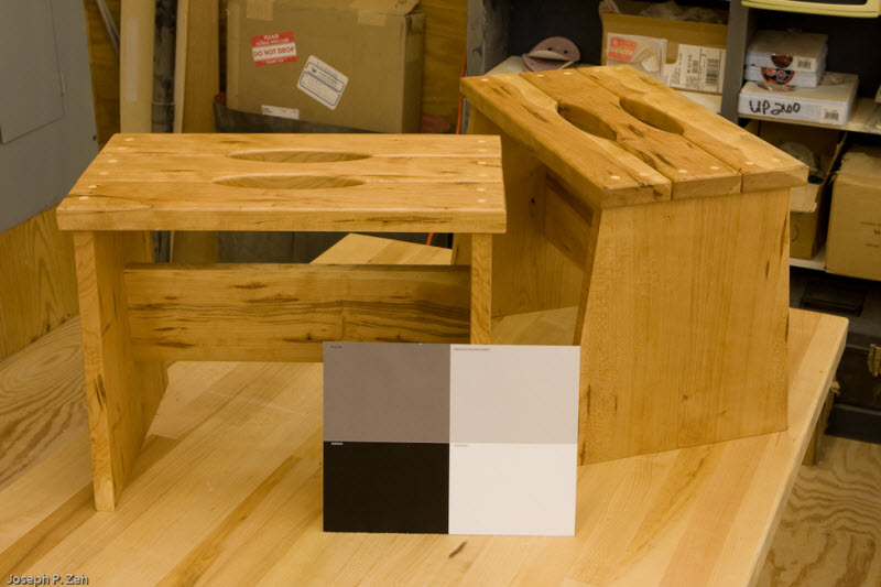 Two Stools With A Gray Card In The Picture