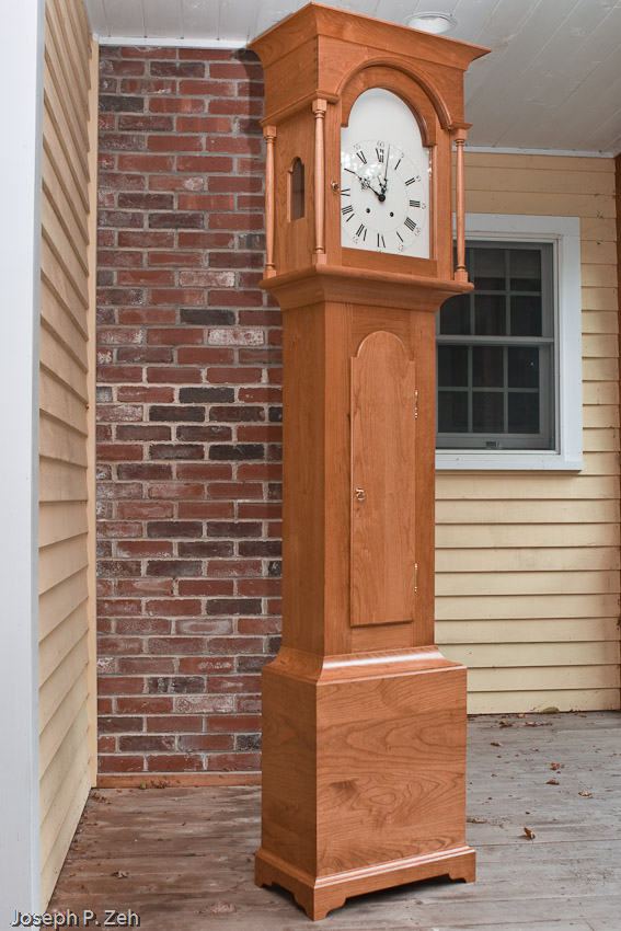 Shaker Tall Clock On My Front Porch On An Overcast Day - See Glare In Glass