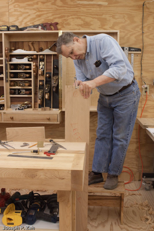 A Stool Comes In Handy To Provide Sufficient Elevation To Saw The Tails