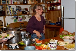 Michele at work in her kitchen talking to the students.