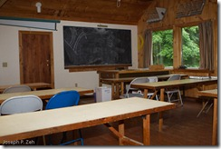 The classroom is on the second floor across from the library.