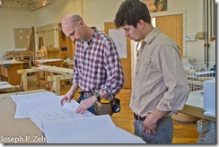 Greg Larson reviews plans with student Matt Richardson.