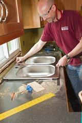 Greg installing a sink.