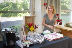 Margaret serving cake at graduation celebration.