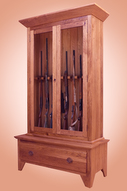 Gun cabinet holds eight guns as shown.