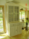 Poplar hutch finished in white pickling.