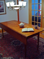 "80"" Shaker drop leaf table, one leaf up."