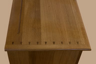 Dovetails joinery shows on the top of the base.